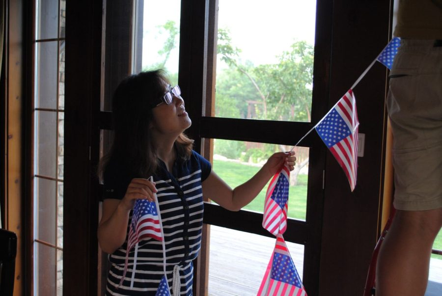 Annie_Liu_putting_up_American_flag_decoration_in_her_home